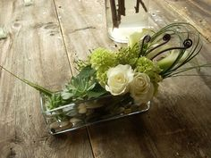 Using a combination of succulents amongst other greens, the Hydrangea, Roses, Calla Lilies, and Fiddlehead allow for the ability to easily freshen up stems as needed.