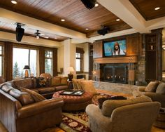 Love this fireplace and tv set-up with the sliding panels and elevated hearth.