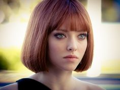 Amanda seyfried  (in time-Movie) hair still cant believe this is the girl from mean girls :O