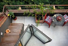 More sun porch ideas... small round table + aluminum chairs (and dig the stairs)