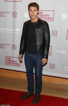 Suave: Nolan Gerard Funk kept it casual in a black T-shirt, worn underneath a black leather jacket