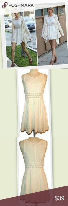 """Free People Daisy Lace Fit and Flare Dress Celeb style as seen on Ms Swift! An unlined panel adds flirty midriff baring dimension and highlights cute daisies around the waist of a full skirted frock covered in patterned knit ivory lace. Back zipper.  Sleeveless.  Scoop neckline.  Also available in black.   80% cotton 20% nylon   Marked size 4  Bust 34"""" Waist 28"""" Hips full  Length 32"""" Free People Dresses"""
