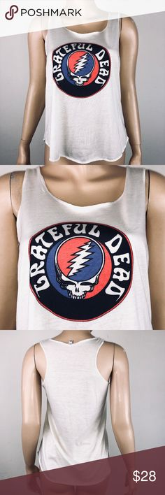 "Grateful Dead Skull Logo Tank Top Shirt Tag Size: S  Chest - armpit to armpit, lying flat - 15.5""  Length - top of shoulder, at neckline to bottom of shirt - 24""  The Grateful Dead was an American rock band formed in 1965 in Palo Alto, California. The band is known for its eclectic style, which fused elements of rock, folk, country, bluegrass, blues, gospel, and psychedelic rock for live performances of lengthy instrumental jams, and for their devoted fan base, known as ""Deadheads"". Unbranded Tops Tank Tops"