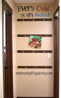 Art wall for kids art work. Clips and wood strips.