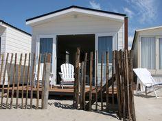 Sleep in one of the cute Dutch beachhouses.