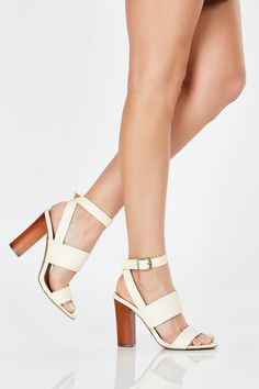 A flirty pair of heeled sandals featuring three strap detailing. Simple buckle for adjustable fit. Keep things classy with a crisp button down and denim cut offs!