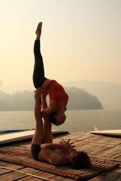 Partner yoga on a dock. Looks so peaceful.