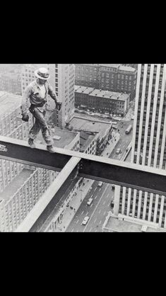 June 1955 : A worker without any safety harness walking on the steelframe of Socony-Mobil Building under construction, New York