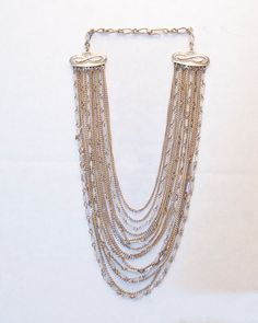 Gold Colored Chains and beads- 14 strands on a vintage style findings. - pinned by pin4etsy.com