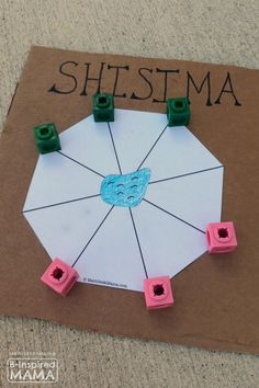 Do your kids ever play learning games?  Which is their favorite?    Shisima - An Fun & Cool Math Game from Kenya - at B-Inspired Mama