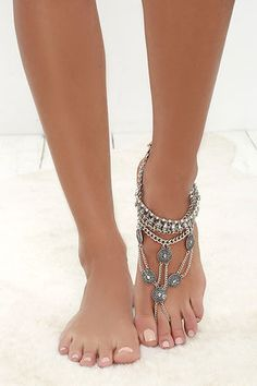 """Give your pedicure a run for it's money with the Best Foot Forward Silver Foot Bracelet! This attention-grabbing piece decorates your foot in layers of antiqued silver chain and engraved charms all the way to a chain toe loop. Bracelet measures 5.5"""" from ankle to ring. Anklet measures 8"""" around, plus a 2"""" extender chain."""