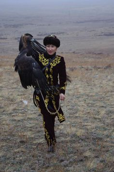 You will never be as cool as this woman.  Eagle hunter Makpal Abdrazakova