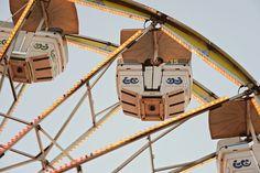 www.frostedproductions.com | #utah #photographer #engagement #photography #unique #ideas #for #engagement #photos #cute #couple #at #the #fair #ferris #wheel #kissing #blue #sky
