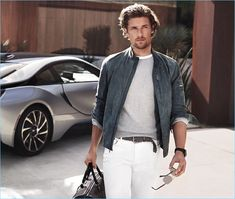 Ready to hit the road, Wouter Peelen sports a grey suede jacket and white jeans from Michael Kors.