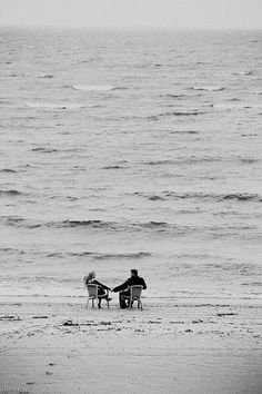 Holding hands by the sea
