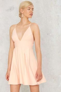 Be the center of attention with this Factory Figure of Peach Fit & Flare Dress.