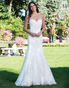 Sincerity wedding dress style 3926 Unique lace placements and neckline trimming make this traditional tulle fit and flare gown even more special for your big day.