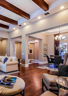 Ceiling beams in your formal adds height and interest to your family room. Seen in Ashlin Park Classical, an Orlando community.