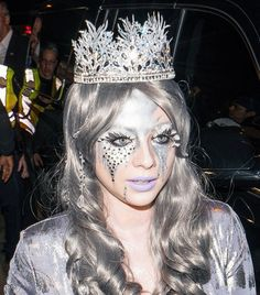 Michelle Trachtenberg used silver makeup and rhinestones to transform herself into an ice queen