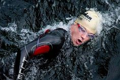 Denmark's Crown Prince Frederik swims during the KMD Ironman Copenhagen, a triathlon which involves swimming, cycling and running August 18, 2013.