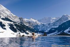 The Cambrian Switzerland | The heated outdoor pool at this design hotel in the Swiss alps gives bathers the sensation of swimming straight into the surrounding snow-capped mountains.