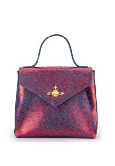 Brighten up your Spring/Summer 2014 with Vivienne Westwood's new and tantalising Cote D'Azur Collection. Perfect for your daily essentials, this playful piece is crafted with a vibrant two-tone colour. With orb studded detailing, this bag opens to expose Vivienne's pink lining, one open pocket and one zip closing compartment. Finished with the unmarked golden Orb to the front, the detachable strap at full extension measures 118cm, whilst the handle measures 24cm.
