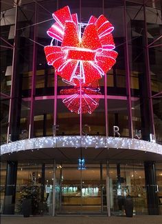 Fun and brilliant the red bow creates an anticipatory mood for shoppers. #LED #lights #holidays #commercialdecor