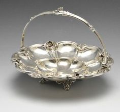 An Early Victorian Silver Swing Handle Basket, The