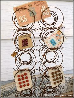 Button Floozies:  Great display for ho-hum buttons on cards using a section of old mattress springs.  Rust is a matter of taste!