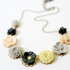Made with all different little flower cabochons in gray, moss, beige and black ranging in sizes from 10mm-15mm.