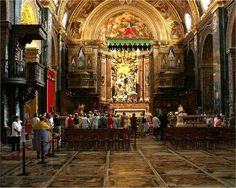 The Co-Cathedral of St. John in Valletta is one of the most interesting churches in Europe. Knights are buried under the floor and each is marked by an elaborate marble cover.