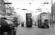 Holloway Road at Nag's Head showing left to right : a trolley bus, a tram and a diesel bus. Also note the overhead power lines and the tramlines. the tall building far right is  the now demolished Malborough Cinema. (photograph from the Warsaw 1948  collection) London Bus, Old London, North London, London Transport, Public Transport, Old Pictures, Old Photos, Rt Bus, Routemaster