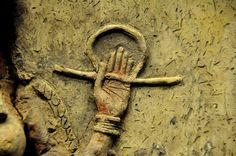 A close up of the goddesses left hand. Her hand clutches the rod and ring symbol of divinity. Traces of the original colour are seen. Also note the details of the bracelets and the creases in her palm. (Photo by Osama S. M Amin) -- Ancient History Encyclopedia