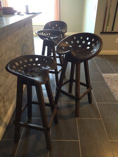 Husband made tractor seat barstools