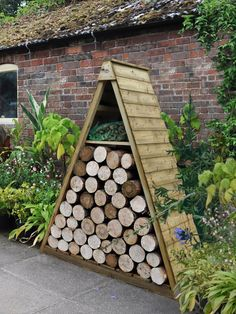 Forest Pinnacle Log Store | This decorative log store is a striking addition to any garden providing an attractive and practical space to keep your logs dry and protected from the elements. Ideal for placing on a patio or against a wall to create a garden feature while keeping your logs within easy reach.