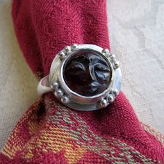 Carved Moon Face Garnet in Granulated Silver Ring 8