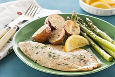This fish bake really is as easy as 1 2, 3. Just bake potatoes, asparagus and tilapia on baking sheets, sprinkle with Parmesan and serve with lemon wedges.