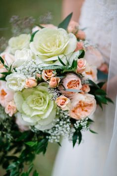 Pastel fall wedding bouquet idea - romantic peach and cream bouquet of garden roses, baby's breath, ornamental kale, and greenery {Brandy Angel Photography}
