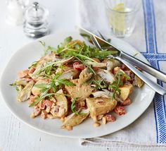 Spice up leftover cooked potatoes with flaked fish, creamy harissa dressing and peppery rocket leaves for a tasty no-cook dish