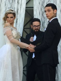 """Andy Biersack's dad tweeted this pic with this caption """"No one would dare to object to the joining of these two in holy matrimony when Andy & Juliet gave them this look. ;)"""" Andy & Juliet Wedding"""