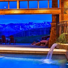 Snowy mountain peaks set a cozy backdrop for this heated indoor pool.