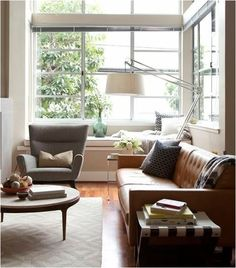 2) Break It Up.  Another way to minimize the visual weight of a set of leather furniture is to break it up. Keep the sofa and find a place for the other pieces. Supplement with upholstered chairs for a chic and collected look instead of a matchy matchy one.