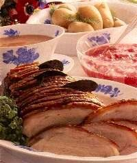 A typical dish for a Danish Christmas dinner. The photo is of Flaeskesteg Pork Roast with Cracklings and Candied Potatoes served on Royal Copenhagen porcelain.