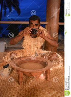 A traditionally dressed native Fijian drinking Kava as a part of a welcoming ceremony.