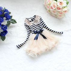 This has been repinned several times a week for months now.  She may not have this dress on etsy at the moment, but I think she'd make it if you ask. I just ordered two other things from her. They arrived quickly from China and seem to be good quality.   18m,24m,2years,3years,4years baby girl dress clothes spring fall dress baby girl toddler outwear navy blue strip tutu dress. $26.99, via Etsy.