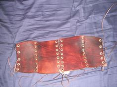 Underbust Corset/Bodice, in brown and brass rivets. £50