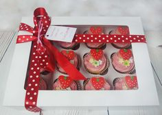 This box of delicious looking strawberry buttercream cupcakes makes a wonderful gift to a loved one! #cupcakes #pinkcupcakes #strawberrycupcakes   https://www.craftycakes.com/
