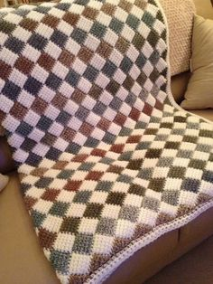 Another tunisian entrelac afghan made for a housewarming gift. I used a 9 mm standard bamboo crochet hook and Waverly yarn in cream and self-striping multi. It's a nice, soft, washable/dryable acrylic yarn to work with. ~ Leslie Molengraaf