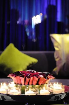 Beautiful Centerpiece Idea - Tightly packed red Calla lilies glow when surrounded by floating candles.