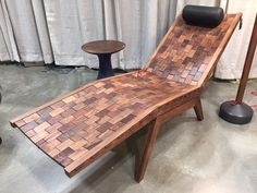 Lounge chair at 2016 American Craft Council Show in St. Paul. Each wood tile is connected with elastic cord, so the seat conforms when you sit on it.